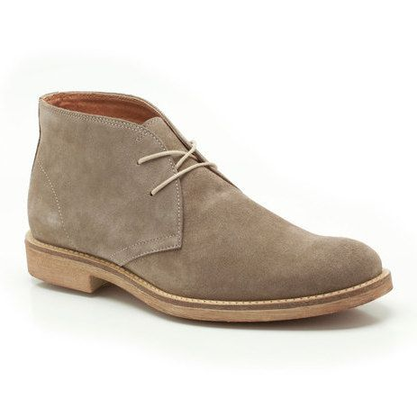 Classic styling with a twist, these men's boots are inspired by the Desert Boot and feature simple clean lines in premium taupe suede. Attractive punched detailing and a stitched construction add tailored appeal. A great smart casual summer look.