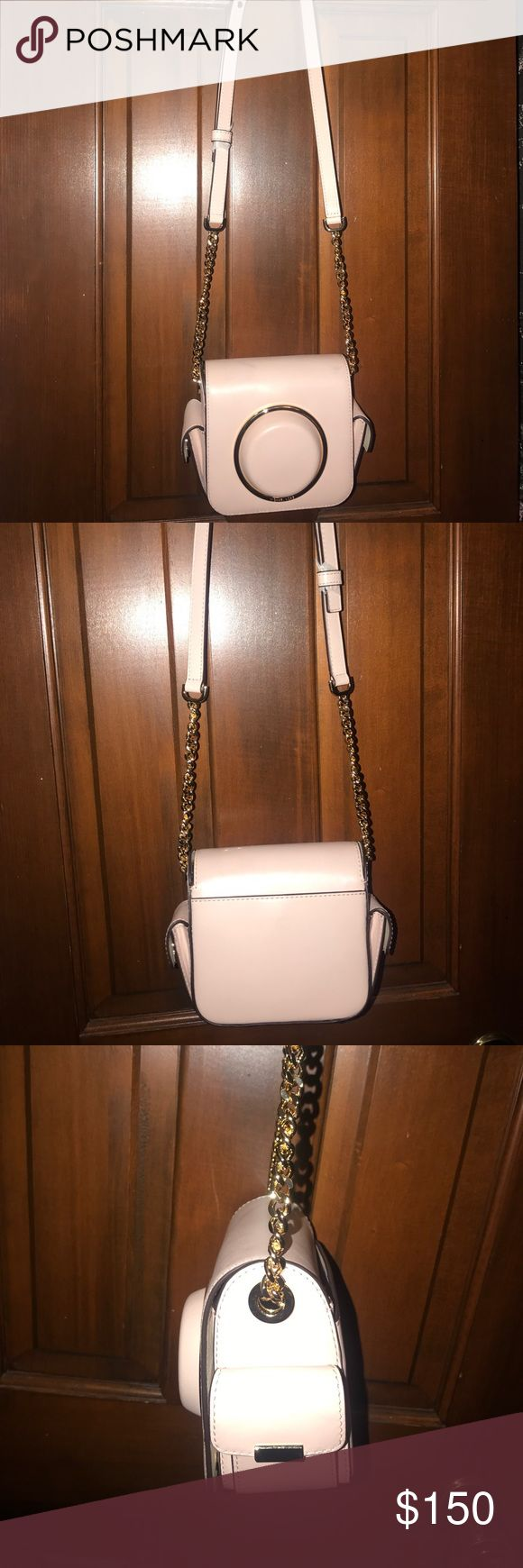 Small Michael Kors purse Small pale pink over the shoulder bag. Multiple pockets with built in card slots. Tags removed but never used. Michael Kors Bags Shoulder Bags
