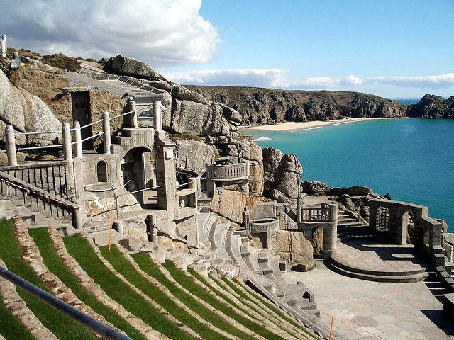 "The Minack Theatre, Cornwall, is an open–air theatre, constructed above a gully with a rocky granite outcrop jutting into the sea (minack from Cornish ""meynek"" means a stony or rocky place). The theatre is located at Porthcurno, 4 miles (6.4 km) from Land's End in Cornwall, England, United Kingdom. The season runs, each year, from May to September and by 2012 some 80,000 people a year see a show, and more than 100,000 pay an entrance fee to look around."