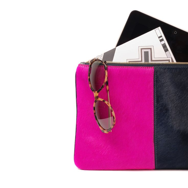 Our Travel Clutch is perfect for travel. Padded and Ipad friendly, take this easy and stylish clutch with you on a JAUNT!  www.jauntaccessories.com