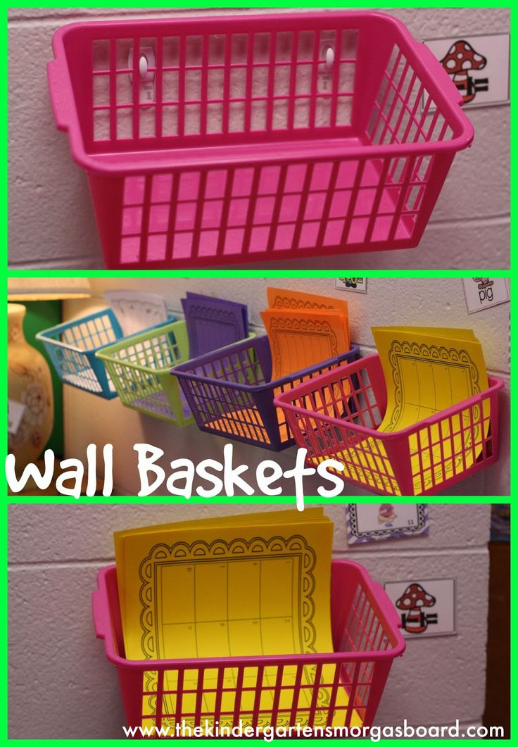 Organize your classroom by Smedley's Smorgasboard of Kindergarten! Stick command hooks on your wall and attach baskets to them.