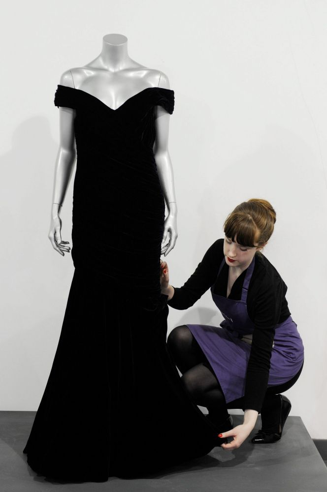 Victor Edelstein evening gown worn by Britain's Princess Diana for the state dinner at the White House in 1985 when Princess Diana danced with John Travolta, during a photocall at the Kerry Taylor Auction house London, Britain, 15 March 2013. The auction of Princess Diana dresses will take place in London on 19 March.