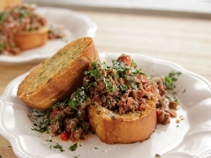 Italian Sloppy Joes recipe from Ree Drummond via Food Network. I reeeeeally want to try this garlic toast!