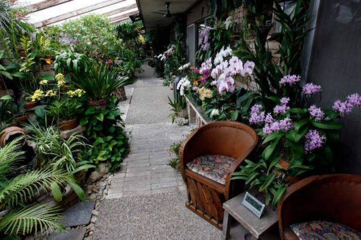 A seating area in Bill Bartlett's orchid garden. Photo: Johnny Hanson, Chronicle