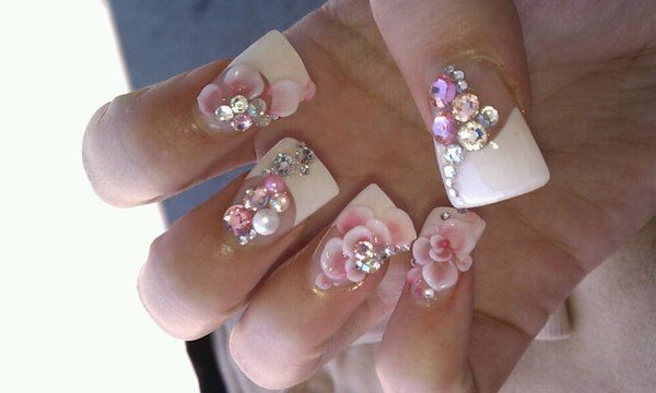 Blinged rhinestones and 3D flowers .... wide tip nails