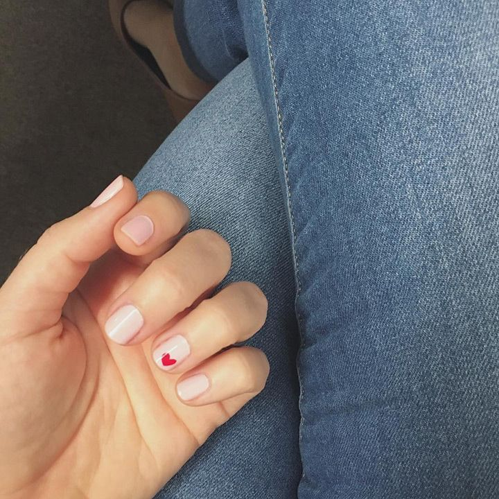 soft pink nails with a single red heart nail design - perfect wedding nails!