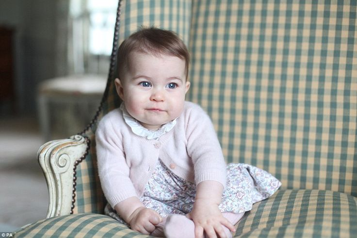 Posing for her mother's camera at six months old: Princess Charlotte seems to have inherited her big blue eyes from her father Prince William