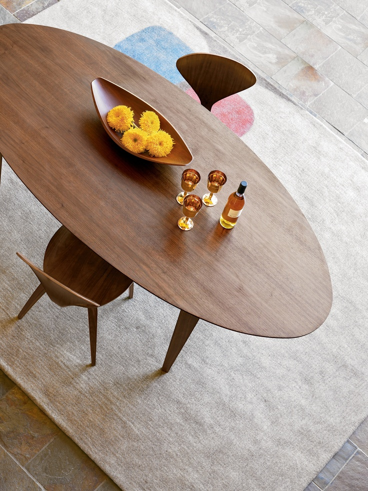 Another dining table I lust after, the elegant curves of this table make group dining cozier. The Cherner Collection Designed by Norman Cherner. #ModernThanksgiving