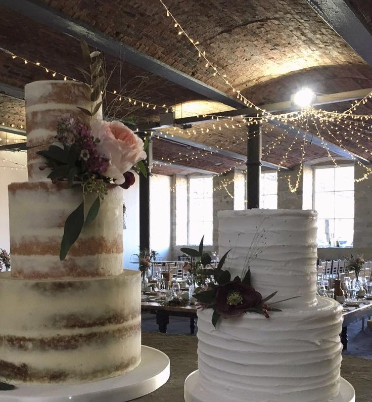 Semi naked cake and rustic iced fruit cake with fresh flowers