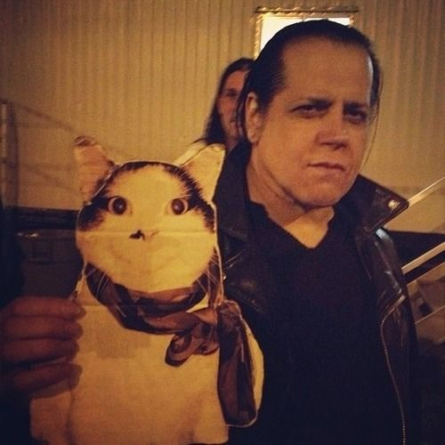 Glenn Danzig holding a picture of a cat. What the hell is going on here?
