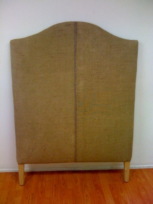 Burlap headboards. Matched with burlap bedskirts (simple box pleat in the corners; nothing frou frou).