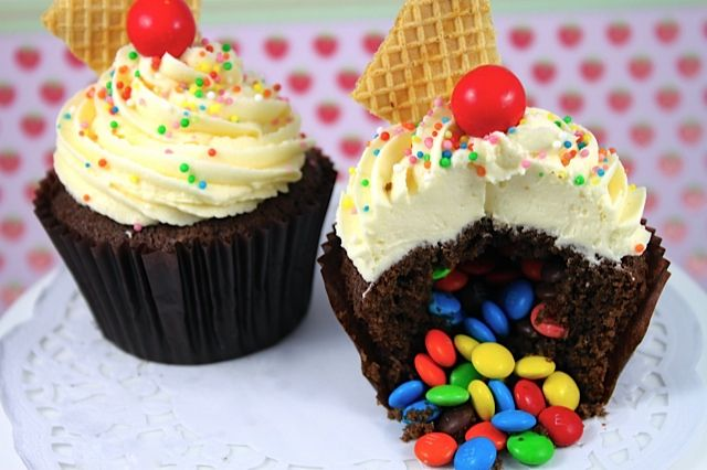 Learn how to make surprise pinata cupcakes with hidden rainbow candy surprise on the inside.