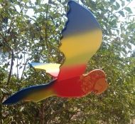 Handmade wooden parrot. It comes in different sizes. You can pull the seashell tha hangs bellow it, and it flies!  See more on www.artsandcrafts.gr