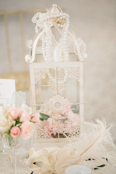pink flowers in white vintage birdcage with pearls wedding centerpiece