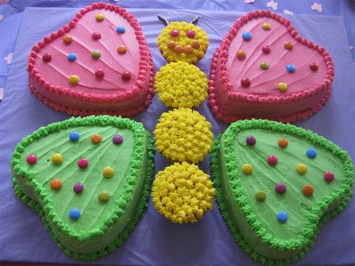 Butterfly cake by Sarah Curtain    this is a super cute one that even I can do!!! looks like heart shaped pans and cupcakes!  NO cutting required!!