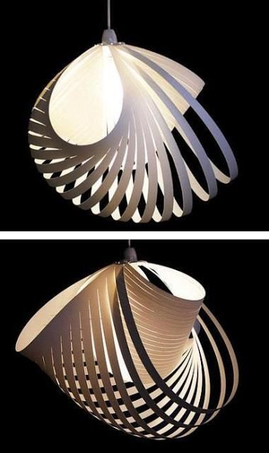 Paper cut light shade. The way this crosses over itself is attractive and creates more interesting shadows.
