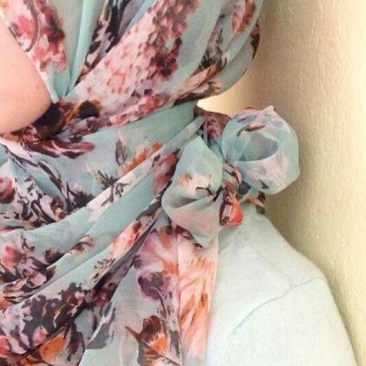 Hijab bow. Video tutorial from Austere Attire. Just tie the bow above the shoulder rather than behind the neck.