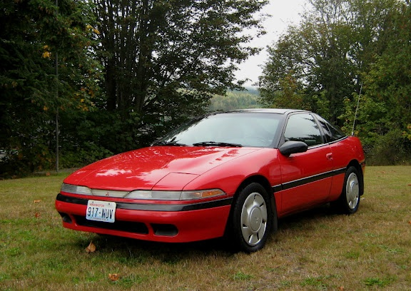 1991 Mitsubishi Eclipse GS my 2nd vehicle...except in white (1st car) - ♥'d it! Picture me rollin'