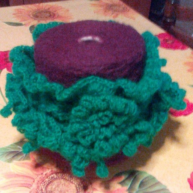 Scaldacollo verde di lana con fiore/bottone