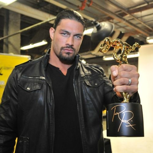 ambreignsfans:  Roman Reigns SIGNED Replica Slammy Award (WWE Auction Photo) 'This replica WWE Slammy was personally autographed by WWE Superstar Roman Reigns after winning the 2014 Slammy for Superstar of The Year. This item was signed on December 9, 2014 at the Columbus Civic Center in Columbus, GA.' (x)