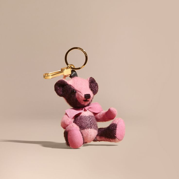 A Burberry charm featuring Thomas Bear, our signature teddy, in soft tonal check cashmere. The design features moveable arms and legs, and a bow detail. This is not a toy and it is intended for collectors of 14 years of age and above.