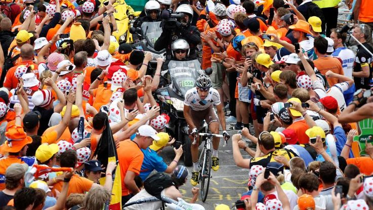 Christophe Riblon rides through the crowd during the TDF 2013 stage 18.  He goes on to win the stage!