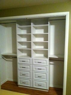 One side upper/lower rods, other side this shelf/dresser combo, center with a desk and shelves. :)