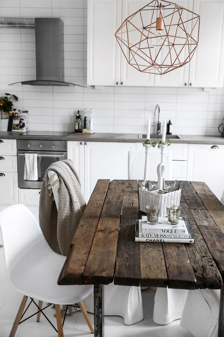 Rustic rough cut table and white chairs