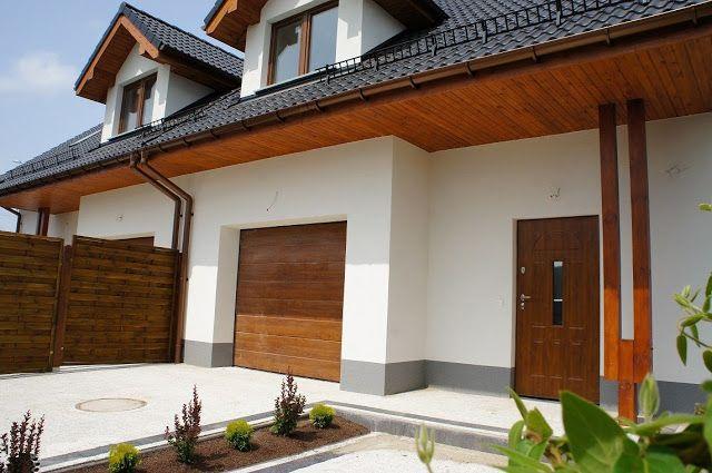 Elewacje Zuzzy: Grafitowe i antracytowe dachy, okna złoty dąb