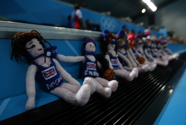 Dolls representing Britain's team are seen lined up in a row ahead of their women's preliminary round Group B water polo match against Australia at the London 2012 Olympic Games at the Water Polo Arena August 1, 2012. REUTERS/Laszlo Balogh