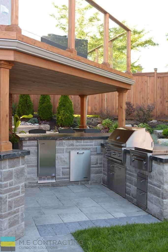 Outdoor kitchen, cedar fence and deck, tempered glass railing, landscaping, interlocking