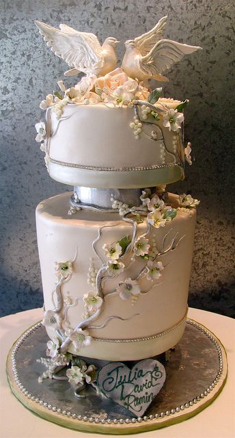 Reminds me of a water fountain with the birds cavorting!  Very creative.  Love Doves - Rosebud Cakes