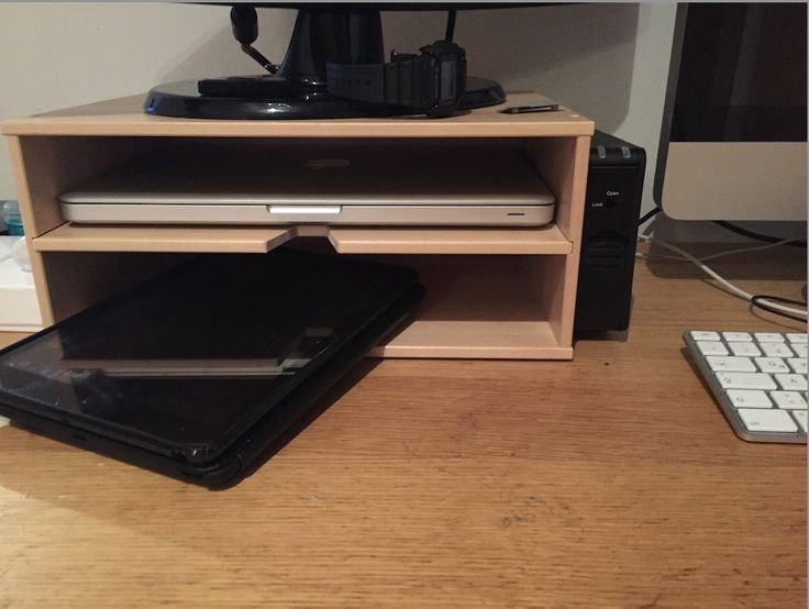 IKEA hack - Forsda (?) Magazine rack turned on its side becomes a monitor stand.