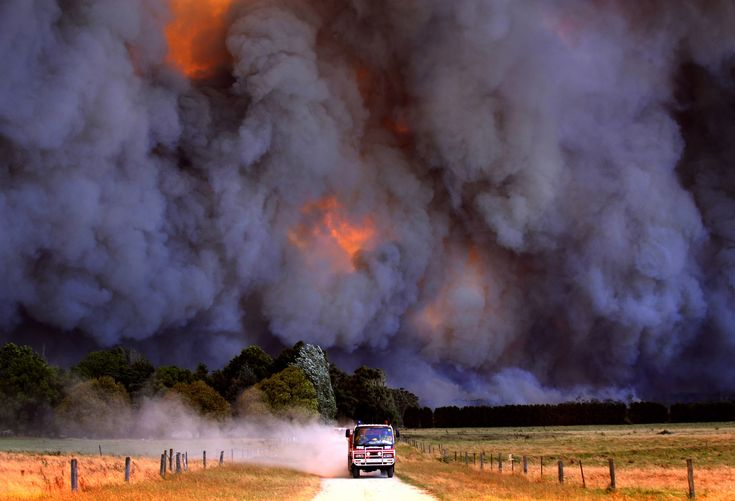 Firemen fleeing black Black Saturday bush fires in Australia.  February 2009.