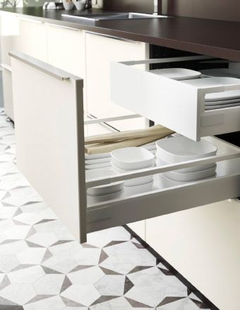 Open kitchen drawers with plates and bowls