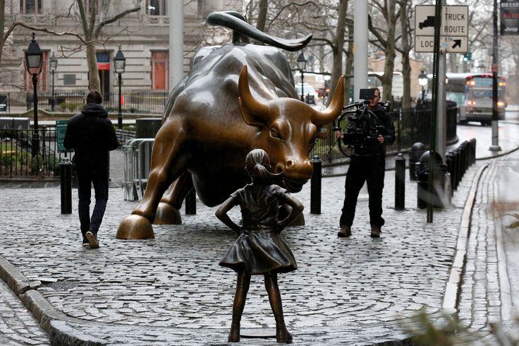 #worldwomensday  A statue of a young girl staring down the Wall Street bull just appeared today in Manhattan