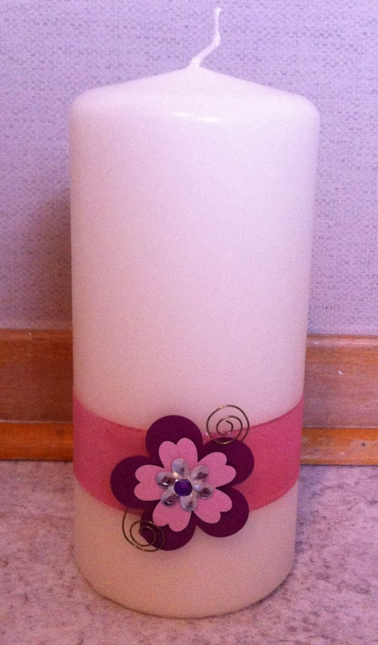 Candle with paperflower for decoration.