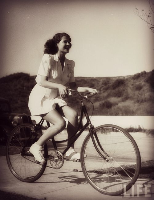 Rita Hayworth riding her bike in California, 1940; by Peter Stackpole.