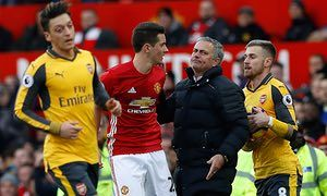 Manchester United manager Jose Mourinho (centre) seperates Manchester United's Ander Herrera (left) and Arsenal's Aaron Ramsey.