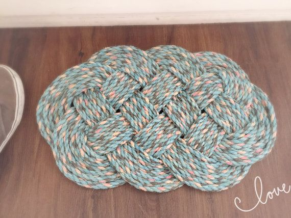 These beautiful door mats are made using reclaimed 12mm rope. They have a lovely colour to them as well as being very strong and heavy. They have been hand made into an Ocean Plait knot using a single piece of rope. This beautiful blue door mat will be the exact one you receive The size of the mat is approximately 22 inches x 15 We have lots of different types of rope that we are working our way through so if you think there is something we can help you with please dont hesitate to ask…