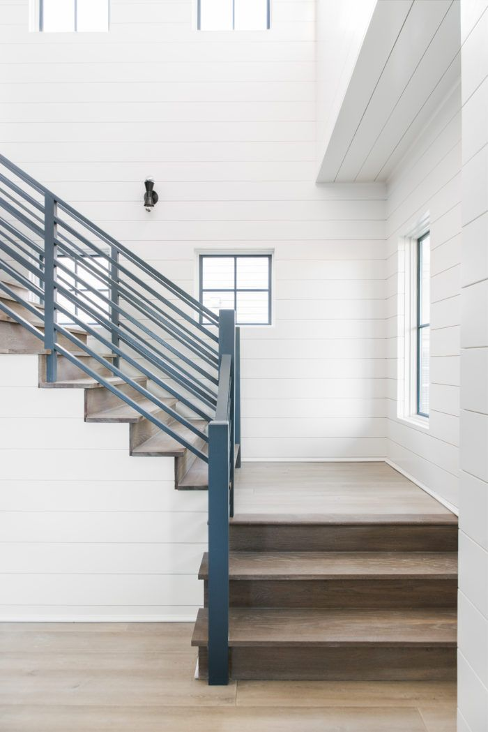 Modern White Shiplap And Wood Stair Tread Staircase With Turquoise Bannister Barrow Building Group Beach House Floor Plans Stairs Trim Modern Stairs