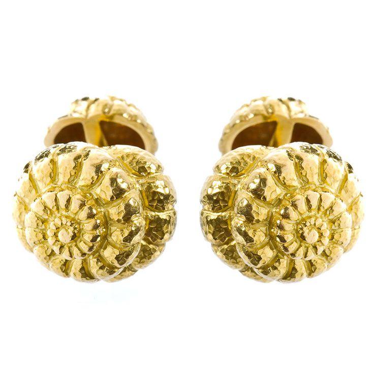 A set of 18 karat yellow gold cufflinks in a shell design by David Webb. Signed WEBB. No. 4402