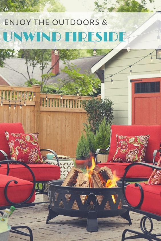 Gather friends and family around a DIY patio block fire pit. Deep, colorful cushions and throw pillows atop lattice-back rocking chairs keep this conversation spot cozy. S'mores optional.