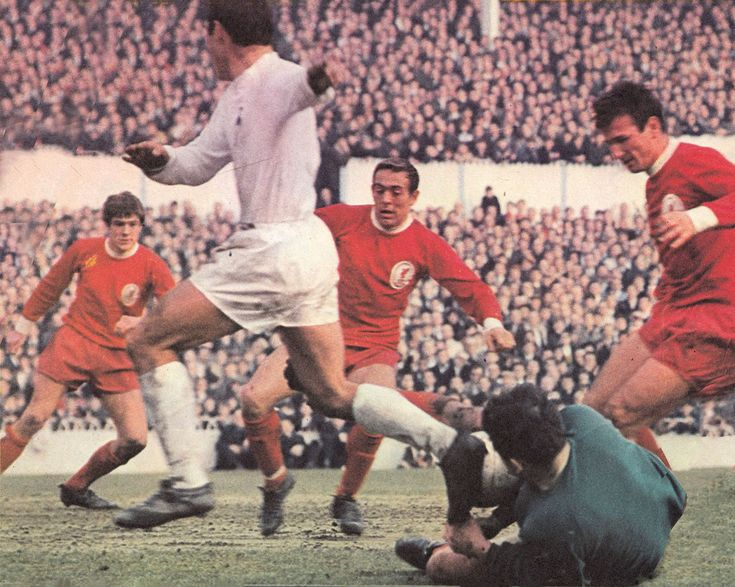 19th October 1968. Tottenham Hotspur inside forward Jimmy Greaves is only half stopped by  Liverpool goalkeeper Tommy Lawrence as team mates Ian St John and Tommy Smith rush to help him out, at White Hart Lane.