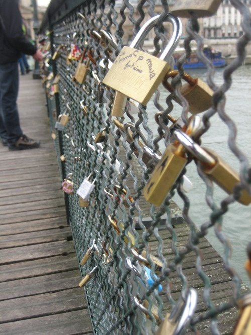 This is a bridge in Paris. You hang locks on it with the name of you & your boyfriend/girlfriend/best-friend then throw the key into the river. So even though the friend/relationship may end, you cant remove the lock. It stays there forever, as relevance to someone once a part of your life.: Locks Bridges, Paris, Buckets Lists, Keys, Hanging Locks, Names, The Bridges, Place, Friends Relationships