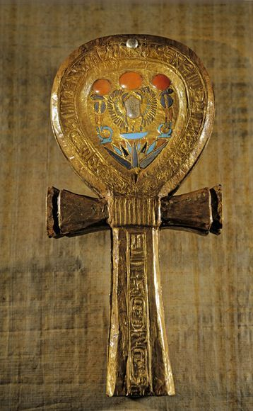 "Ankh  This ankh-shaped, gold-sheathed mirror case was taken from the tomb of Tutankhamun in southern Egypt's Valley of the Kings. The Ankh form, found in many ancient Egyptian tombs, is the Egyptian hieroglyphic character meaning ""life."""