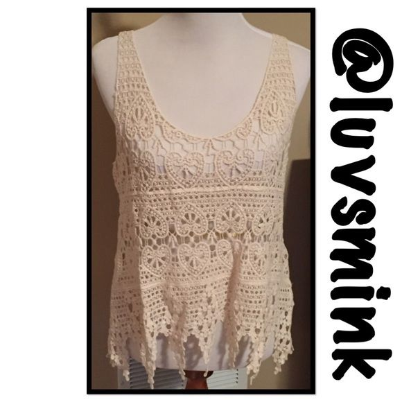 CROCHET CAMI TOP - IVORY This soft crochet layering piece is perfect over a special bralette, a cami, swimsuit, etc.  put any and all colors underneath this lightweight, yet sexy crochet top with a special finish along the bottom.  Color is Ivory/ Beige; and looks like a Natural color.  No holds or trades; price is firm unless bundled.  This listing is for a size S/M Boutique Tops Camisoles