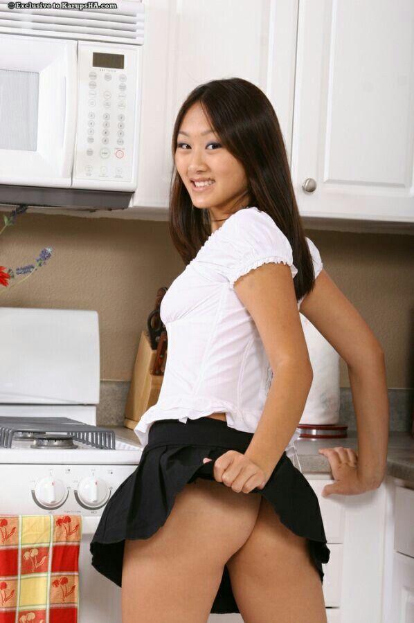 Pretty teen brunette kitchen posing thanks
