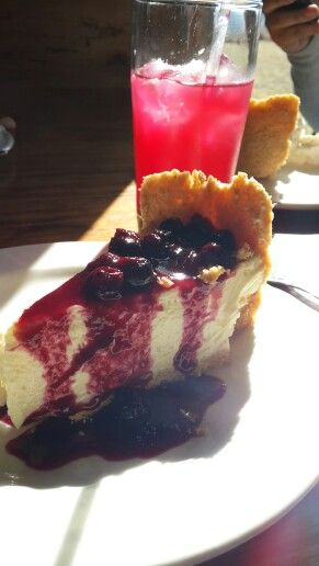 """Homemade lemonade and blueberry cheese cake with a veiw of the berg at """"blueberry hill""""."""