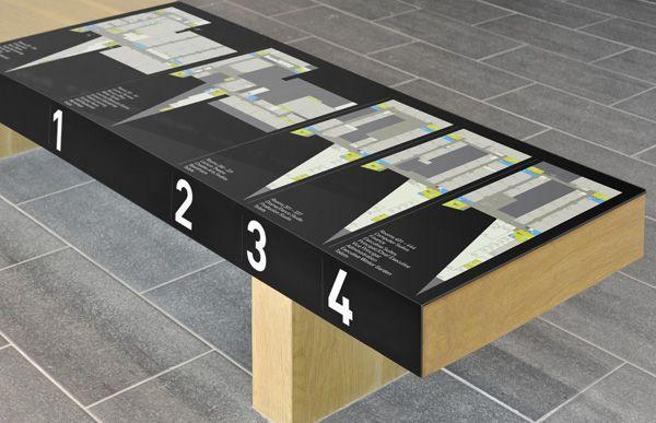 Way finding floor plan sign juxtaposed on bench in lobby | Marque (Glasgow, UK) , via IdN Creators